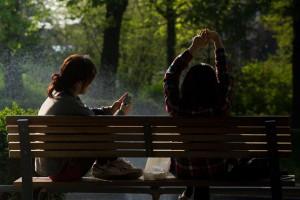 bench-people-smartphone-sun-small